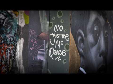 "Toronto graffiti artists ""paint the city black"" against racism"