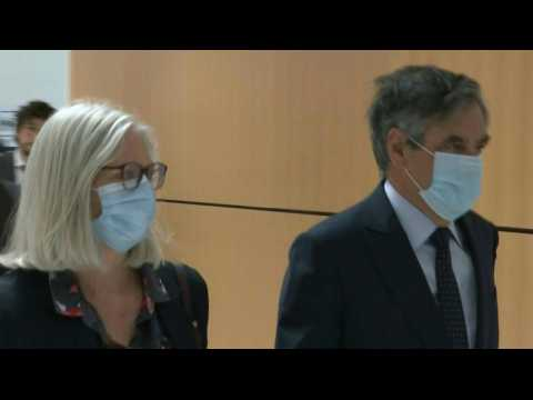 French ex-PM Fillon and wife arrive for Paris court's decision