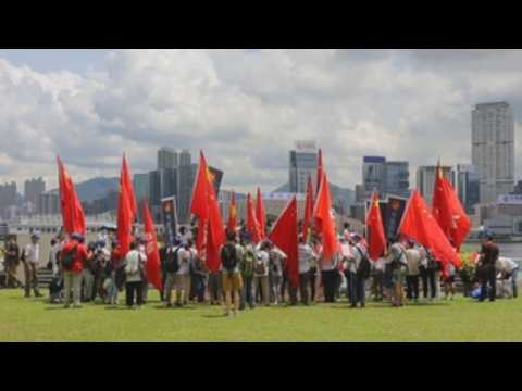 Pro-China protesters celebrate passage of controversial national security law in Hong Kong