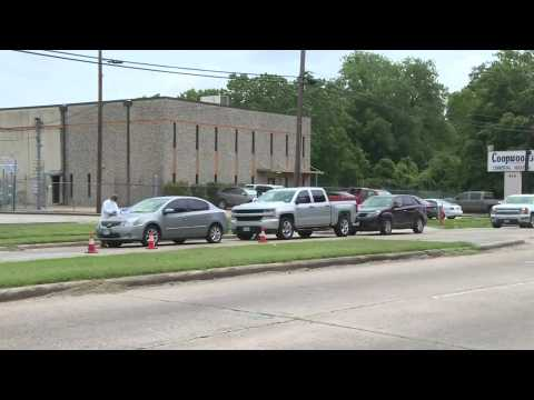 US: dozens of cars line up at a COVID-19 testing site in Houston, Texas