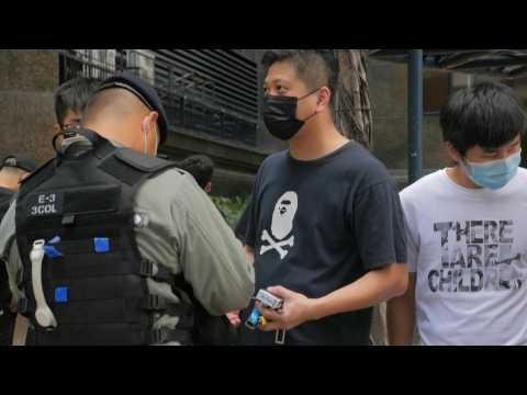 Police search people in Hong Kong after Beijing imposes security law