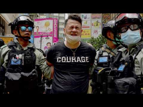 Hong Kong police make 'dozens of arrests' under new security law