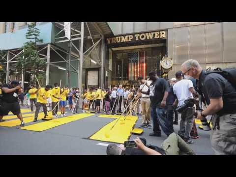 New Yorkers paint a mural for Black Lives Matter in front of the Trump Tower