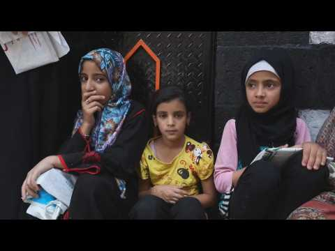 Dozens of people line up for food in Yemen