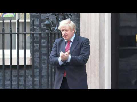 British PM Boris Johnson joins 'Clap for Carers' tribute on Downing Street