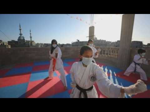 Palestinian karate coach trains with his family amid lockdown