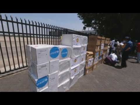 Humanitarian flight with 10,000 COVID-19 test kits arrives in Yangon