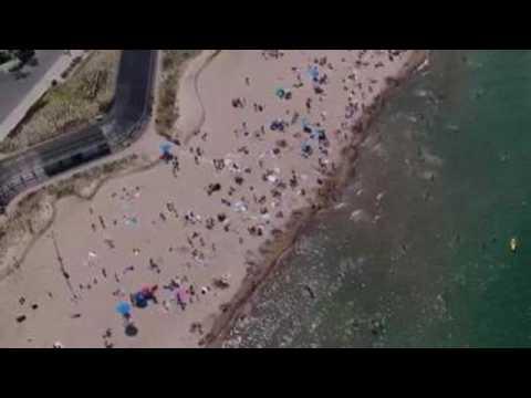 Lake Michigan beaches reopen after coronavirus closure