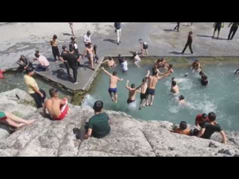 Iranian families enjoy the good weather at Shahre-Ray pools