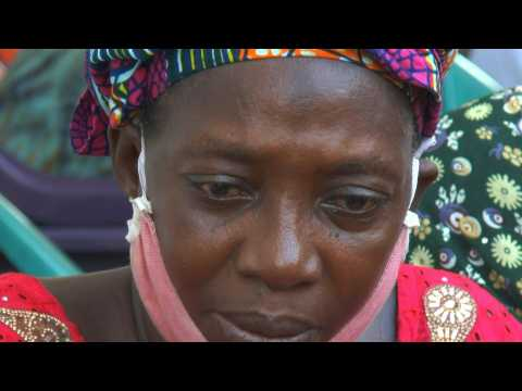 Mourners gather at the home of Guinean singer Mory Kante