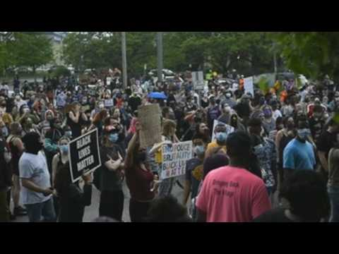 Hundreds protest in Minneapolis over death of black man in police custody