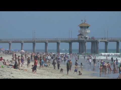 Beachgoers enjoy sand and sun in California on Memorial Day