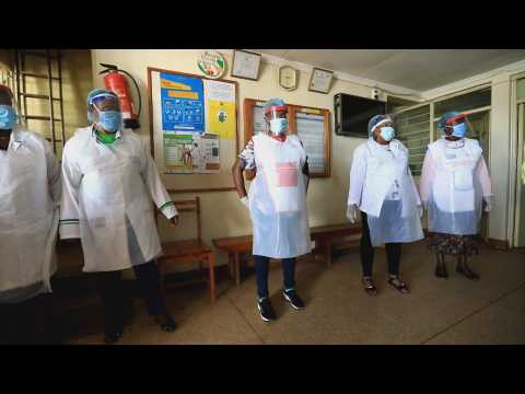 Young unemployed workers make protective masks in Nairobi
