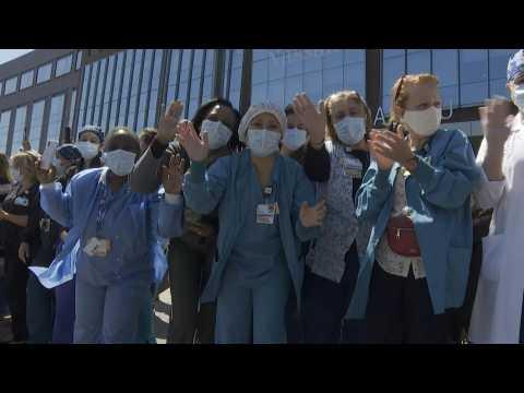 Bagpipes and parade honor medical staff at a Long Island hospital