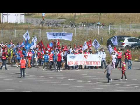 Thousands of employees protest Airbus job cuts