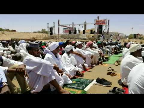 Sudanese protesters take part in the Friday prayers near army HQ