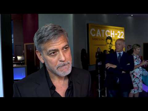 George Clooney's production partner vowed to give up bikes as he held actor's head in his arms