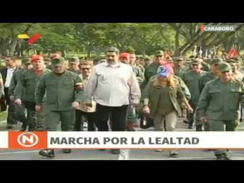 Venezuela's Maduro takes part in military parade