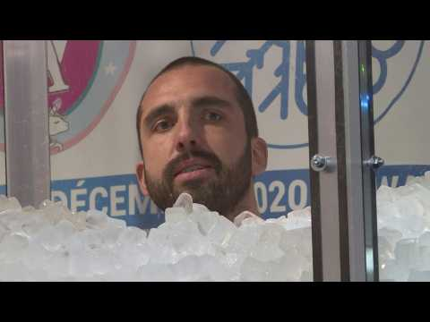 Up to his neck in it: 'Ice man' sets immersion world record in France