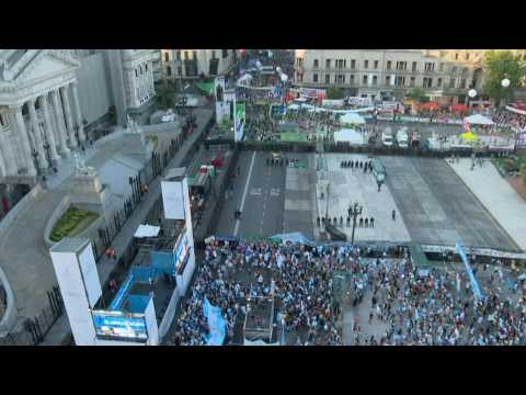 Face to face, pro-choice and anti-abortion activists gather outside Argentina's Senate before vote