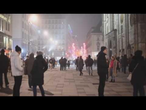 Austrians celebrate New Year's eve on streets of Vienna despite nationwide lockdown