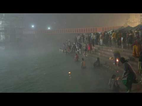 Hindus gather at the river Ganges before sunrise for Kumbh Mela