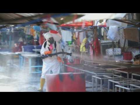 Bangkok's major fresh market shut, disinfected after vendors test positivefor COVID-19