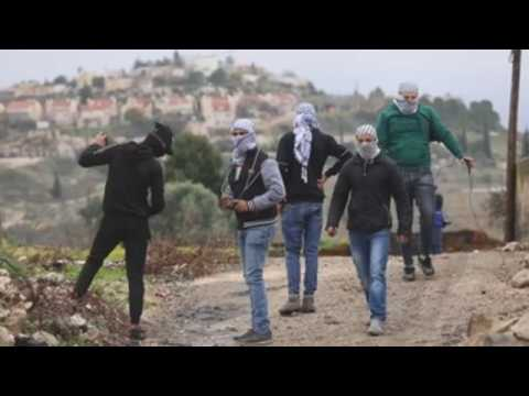 Clashes between Palestinian and Israeli forces leave at least 22 injured