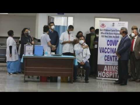 India's Minister of Health is vaccinated against covid in New Delhi