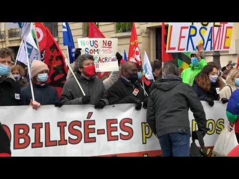 French teachers strike in Paris over government's response to COVID-19