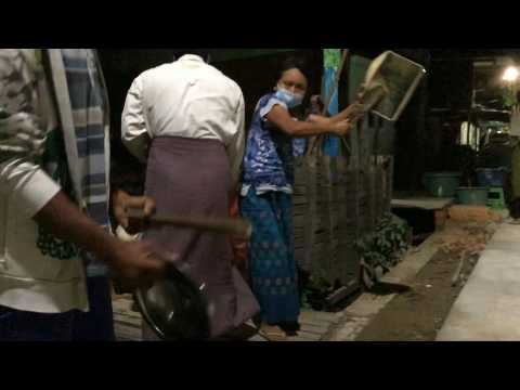 Yangon residents protest against the coup by banging pots and pans