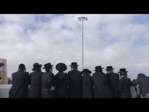 Thousands of ultra-Orthodox Jews infringe lockdown to attend rabbi's funeral