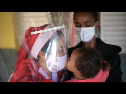 A safe embrace: Mrs Claus greets disadvantaged children in Brazil amid pandemic