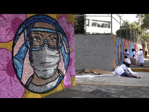 Artists paint mural in Mexico to honour nurses helping in fight against COVID-19