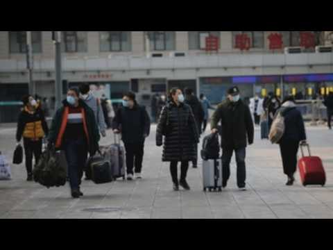 Chinese people travel home early to celebrate Lunar New Year amid pandemic