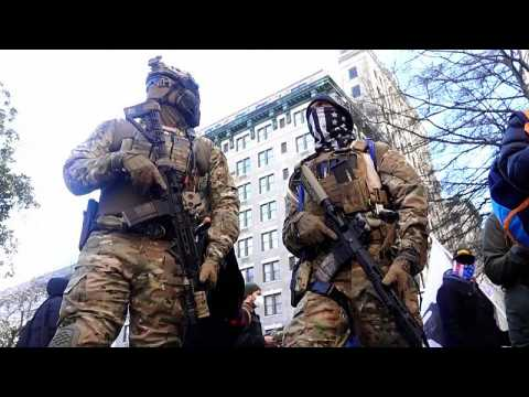 Heavily armed Trump supporters march ahead of Biden inauguration