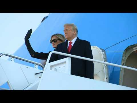 Trump boards Air Force One for final time as president