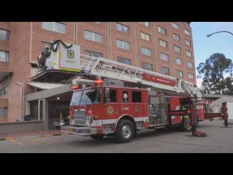 Bogota firefighters take gifts to hospitalized kids, seniors