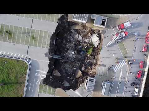 Giant sinkhole swallows cars and trees at hospital in Naples