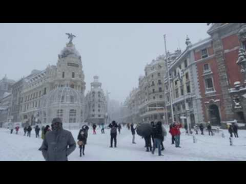 Madrid residents enjoy day out in snow-covered city centre