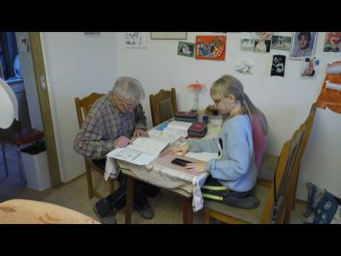 Old school: German great-granddad pitches in with home-schooling
