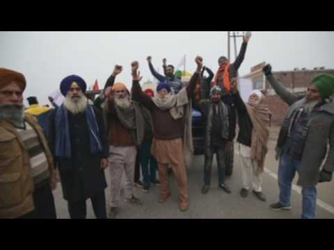 Angry farmers march to India's capital to protest against new farm laws