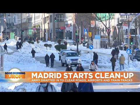 Army drafted in to clear roads, airports and train tracks after unusually heavy snow in Madrid