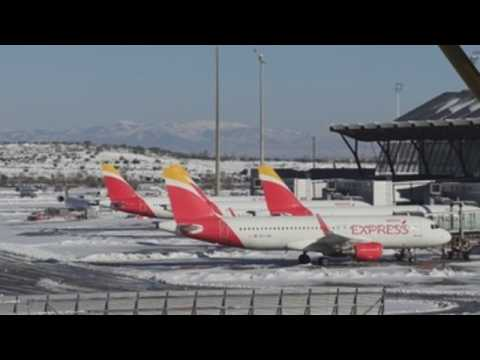 Madrid airport gradually reopens after storm hits Spain