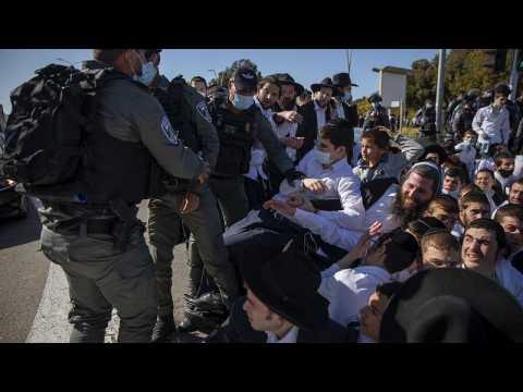 Coronavirus: Ultra-Orthodox Jews clash with Israeli police to prevent closure of religious school