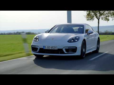 The new Porsche Panamera Turbo S E-Hybrid in Carrara White Driving Video