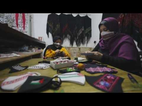 Palestinian family makes face masks with Palestinian patterns to export to Europe