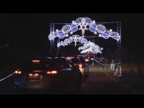 Mexican children enjoy Christmas lights from their cars to prevent contagion